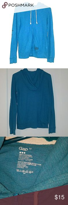 Teal GAP Lightweight Zip Up Hoodie Teal lightweight zip up hoodie from the GAP. Very good used condition. Can either be worn long sleeve out rolled up for 3/4 length sleeves GAP Tops Sweatshirts & Hoodies