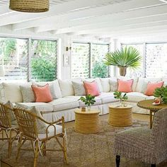 Dynamite retro rattan living room: A series of love seats combines to form a substantial 16-foot-long sectional sofa to easily accommodate a crowd. Quirky rattan pieces add hip '60s flair to this classic beach sitting room. Coastalliving.com