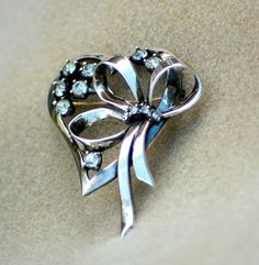 Offered by HighClassHighway is this Gorgeous Vintage Sterling Silver Heart Brooch. It has eight 5mm Clear Color Prong Set Rhinestones and four
