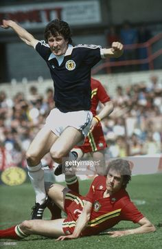 Circa 1977 International Match Wales v Scotland Scotland's Derek Parlane hurdles an opponent Derek...