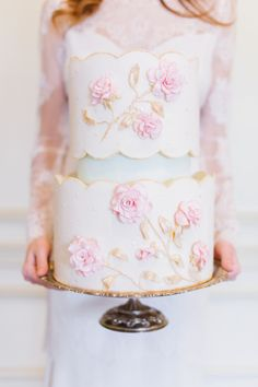 pretty pink and white wedding cake with flowers