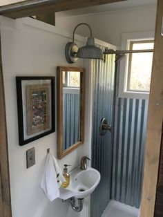 60 Genius Tiny House Bathroom Shower Design Ideas Tiny homes have to make efficient use of space and that includes the bathrooms. A tiny house bathroom has to […] Cheap Tiny House, Tiny House Swoon, Tiny House Plans, Tiny Guest House, Shed To Tiny House, Tiny Bathrooms, Tiny House Bathroom, Tiny House Shower, Home Renovation