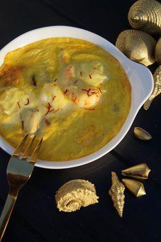 Gratin de fruits de mer à base de moules, crevettes, coquilles saint Jacques, langoustes, entourées d'une délicieuse sauce au safran légèrement rehaussée de Cognac