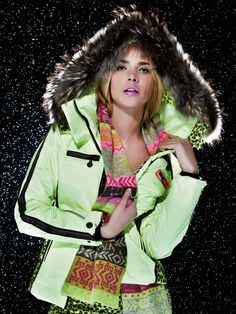 This is one of Sportalm most exquisite designer ski jacket for the fashion forward women. The hood has a finn raccoon fur trim, the piping details are unique and the color is bold and beautiful. This ski jacket represents the typical Sportalm look for skiing, distinctly European and ready to go either on the slopes, apres, or out on the town. Match it up with Sportalm's Mademoiselle Tigerprint ski pant for a stunning ski outfit.