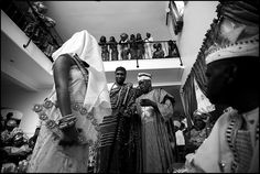 Bride is presented to her groom. Notice that her face is covered.
