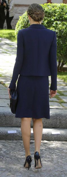 Queen Letizia repeated the exact outfit she wore 2015's National Day parade an ensemble consisting of an A-line dress made from double crepe wool, featuring a midnight blue velvet ribbon trim, and a matching cropped jacket in the same tone. Also tonal blue accessories: Magrit midnight blue patent pumps, Felipe Varela ocean blue leather clutch with Swarovski crystals, and Bvlgari aquamarine teardrop earrings. Miguel de Cervantes 2015. April 23, 2016 in Alcala de Henares, Spain.