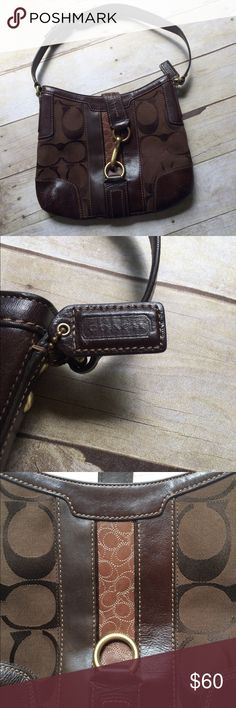 ✨NEW Listing✨Coach Hampton Signature shoulder bag Coach Hampton Signature hobo shoulder bag in brown. Leather Signature insert on front with brass clip closure. Zip top closure, fabric liner. Style D0768-11067. Some minor wear to edges, as pictured. Coach Bags Shoulder Bags