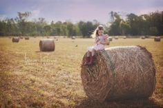 I've been wanting to get photos in a paddock of round bales for a while. I finally got my moment and couldn't love it more. www.taniarainephotography.com #daughter #imagine #portrait #photography #outdoor #hay #country #farm #cowgirl