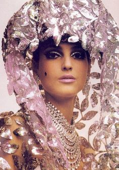 Benedetta Barzini in a sequinned headdress, 1964. Photo by Melvin Sokolsky.