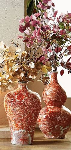 Chic and sophisticated, our Coral Ming Large Ceramic Collection features handpainted oriental art motifs in vibrant shades of coral and white. Prevalent during the Ming Dynasty, the low temperature ceramic glaze pigment yields a stunning hue. These one-of-a-kind works of art make even more of an impact when displayed with multiple pieces.