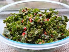 The Best Kale Salad with Romano Cheese, Breadcrumbs, Pomegranate Seeds, Pecans, and Coconut Bacon