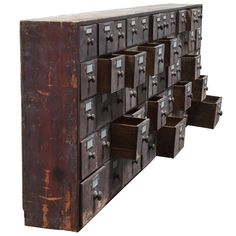 Monumental 19th Century Wall Mounted Bank of Seed Drawers  England  Circa 1880  Large Bank of Wall Mounted Seed Drawers original hardware, painted surface.