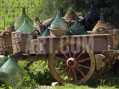 http://www.art.com/products/p10027775459-sa-i5790153/rocco-fasano-discarded-wine-demijohns-in-cart-at-villa-a-sesta.htm