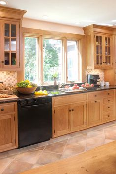 Shaker cherry kitchen black knobs sink area