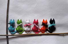 felt kittens in a row
