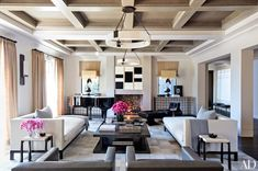 Modern living room with coffered #ceiling and two #chaise loungers