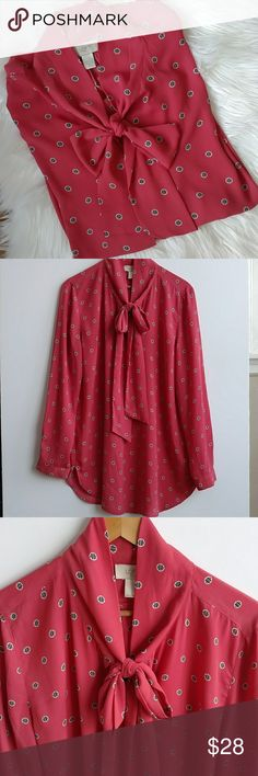 """Loft Outlet Salmon Polka Dot Pussy Bow Blouse - L Loft Outlet salmon colored polka dot pussy bow blouse. Size Large. Color appears darker in some of the photos but is resembles most closely the color in the image showing the LOFT tag & size. Top is loose & flowy & has button cuffs. Beautiful!  100% polyester. Machine was cold. Shirt in great shape! Lay flat measures: Chest: 43"""" Shoulder: 16.75"""" Length: 29.5"""" Sleeve: 23.25"""" Questions? Just ask! LOFT Tops Blouses"""