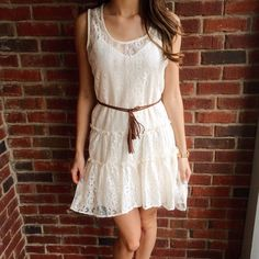 "Cream Lace High Low Dress This free-spirited lace overlay dress comes with attached cream slip underlay and the perfect brown fringe belt to accessorize! Fits best on a juniors size small. Excellent, like new condition. Model is 5'4"". City Triangles Dresses High Low"
