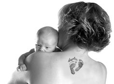 It might be a baby's footprint, a child's name, or a favorite portrait, but whatever the design, more and more Dayton women are choosing tattoos which reflect their roles as mothers.