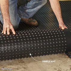 Plastic drainage mats, or dimple mats, allow air to circulate under the flooring and provide a moisture barrier. They also provide an insulating layer of air that separates the floor from cold concrete, reducing the potential for moisture damage from condensation or water vapor migrating through the concrete.