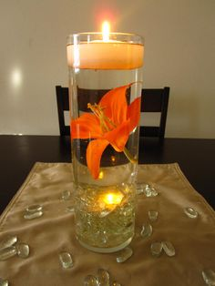 small floating candles candle wedding centerpieces centerpiece kit orange by rose Floating Candles Wedding, Simple Wedding Centerpieces, Floating Flowers, Wedding Decorations, Table Decorations, Orange Centerpieces, Sunflower Centerpieces, Centerpiece Flowers, Wedding Table