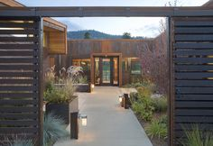 love the center yard....hmmm Contemporary Entry by Balance Associates Architects
