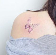 Pink butterfly tattoo by Hello Tattoo