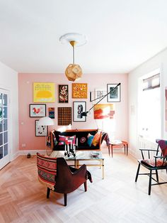 Colourful, creative and inspiring pink living room.