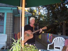 Playing music(Nancy) on the deck of our house on Fire Island.