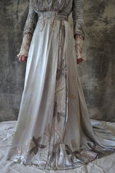 Edwardian silver silk gown, circa 1910. Absolutely luurvely. Even with the age marks on it.  http://www.etsy.com/listing/76537557/downton-abby-edwardian-silver-silk