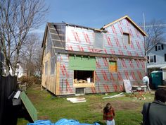 Wrap house with insulation