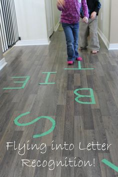 Such a fun way to practice letter recognition with preschoolers!!!  Paper airplanes and painters tape - simple and fun alphabet recognition activities.