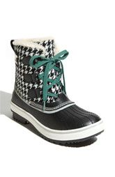 Sorel boots. I have this, my laces are hot pink! perfect for the rain/cold!