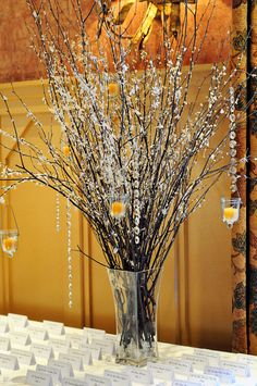 Winter wedding centerpiece with hanging candles- pretty much already have this..