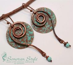These earrings are made from copper that has been die cut and given a deep verdigris patinar. After filing and hammering the edges, I added a spiral