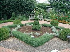 """Herb Garden @ Lexington, Kentucky Arboretum--""""Gray santolina, germander, boxwood and creeping chamomile make up the innermost garden, surrounded by a brick walkway with benches. The next circle includes annual and perennial plants partitioned into four sections: medicinal, dye, cosmetic and culinary. A holly hedge encircles the entire garden, creating a quiet, fragrant and cozy setting."""""""