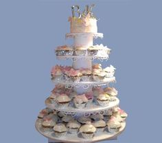 DIY cup cake stand Thinking small cake for cutting and cupcakes for everyone...i'm not much of a cake eater..