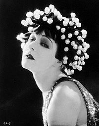 Alla Nazimova with a costume headpiece festooned with pearl-like beads known as Salomé wig designed by Natacha Rambova,1922
