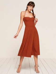 For the warmer days ahead. This is a midi length dress with a sweetheart neckline and an open back.