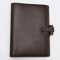 AVAILABLE Filofax Piccadilly Grained Calf Leather Brown Personal Organizer RARE VINTAGE  Material: Grained Calf leather Color: Brown Features:  On the left: 8 credit-card pockets full-height pocket On the right: concealed full-height zipped-pocket With two leather pen loops and leather strap with visible popper Dimensions: 145cm x 35cm x 188cm  Ring Size: 23mm  In preloved and used condition. With various marks on the leather from storage and use. Please view my listing on eBay so you can…