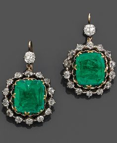 A XIXth century emerald, diamond, gold and silver ear pendants.  Rectangular emerald, brilliant cut diamonds, 18K pink gold and silver,  gross weight: 8.7 gr. total weight of emeralds: about 9 carats.  Dimensions: 3.2 x 2 cm