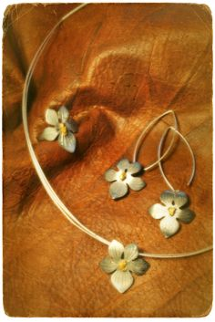 Viola Epipsila silver & gold jewellery set - ring, earrings and pendant. Handmade by Tytti Bräysy