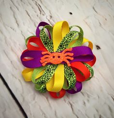 A personal favorite from my Etsy shop https://www.etsy.com/listing/469311606/halloween-hairbow-spider-hairbow