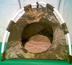 Camo Heavy Wt. Fabric Pup Tent Pet Bed. Available @ http://stores.sharonsdecoratedbooks.com/ For Dogs, Cats, Ferrets, any Small Animal. Can also be used 4 your precious ones toys, Dolls, Stuffed Animals. All Pet Beds are handmade and made when ordered and payment is received. The average time that it takes for the Pet Bed to ship after payment is usually Five business days. Small Bed 28$ Large Bed 33$