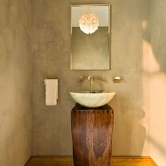 AWESOME rustic raw-edge wood as a bathroom basin stand.