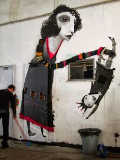 Greek urban artist Alexandros Vasmoulakis at work (Athens, Greece)