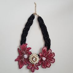 Buy Embroidered Red and Pink Flower Batik Necklace in Singapore,Singapore. Embroidered Red and Pink Flower Batik Necklace is made using Printed Batik with embroidered edges, metal and bling embellishments and braided beaded chain. Flower Necklace, Crochet Necklace, Handmade Accessories, 1 Piece, Red And Pink, Pink Flowers, Singapore, Embellishments, Collars