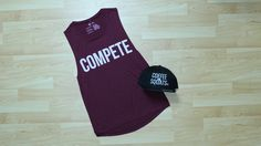 Women's Competitor muscle tanktop, available in maroon.
