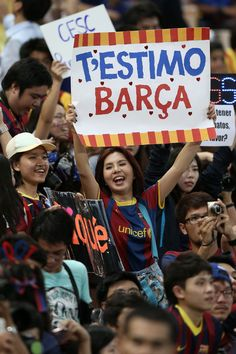 A Barcelona fan cheers during the international friendly match between Thailand XI and FC Barcelona at Rajamangala Stadium on August 7, 2013 in Bangkok, Thailand.
