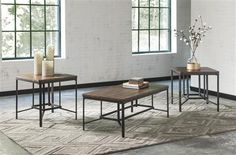 The interlocking geometric bases of this Signature Design by Ashley Newelk 3 Piece Coffee Table Set bring industrial chic design home. This set includes. 3 Piece Coffee Table Set, Coffee And End Tables, End Table Sets, Modern Coffee Tables, Living Furniture, Modern Furniture, Furniture Design, Living Room Table Sets, Living Room Decor